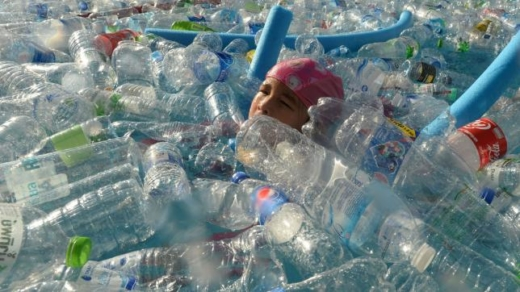 A child swims in a pool filled with plastic bottles during an awareness campaign to mark the World Oceans Day in Bangkok on 8 June. Photo: AFP Tag: Canada, Plastic, PollutionA child swims in a pool filled with plastic bottles during an awareness campaign to mark the World Oceans Day in Bangkok on 8 June. Photo: AFP Tag: Canada, Plastic, Pollution   #Canada #banplastic #plastic #ban #chaild