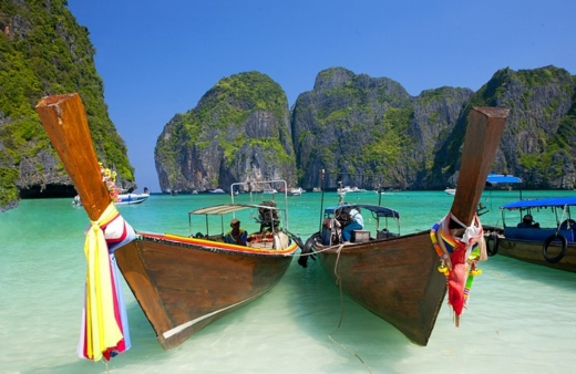 In Ko Phi Phi, a small archipelago in the Krabi Province of Thailand, lush limestone peaks rise from the tropical sea, and warm waters lap on palm-lined sugary shores. Slammed by the tsunami in 2004, Ko Phi Phi has now recovered. Its natural beauty still recalls the tropical island dream evoked in the famous Leonardo DiCaprio movie, The Beach, which was filmed here at Maya Beach on the smaller neighboring island of Ko Phi Phi Leh. Ko Phi Phi Don is the only inhabited island and offers day trips to the surrounding islands. Other popular activities include swimming, snorkeling, and superb diving.
