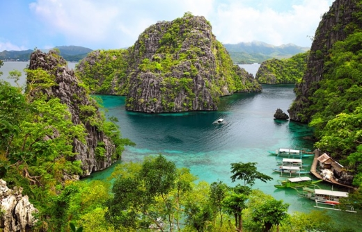 This island province stretches southwest to Borneo with lush limestone peaks rising from a jewel-like sea so clear, that you can almost see the expressions on the fish from above the surface. Slivers of gleaming white sand fringed with rustling palms rim many of these jungle-clad islands, while under the water, coral reefs flourish with an impressive diversity of tropical fish, offering some of the best diving in the world. Other attractions include the islands' unique wildlife, emerald lakes, and quaint fishing villages. Coron is home to plush resorts, and El Nido drips with natural beauty and is one of the most alluring islands in the chain. From here, you can island hop around the spectacular Bacuit archipelago. One of Palawan's top attractions is the World Heritage-listed Puerto Princesa Subterranean River National Park, an impressive limestone cave system with a long underground river.