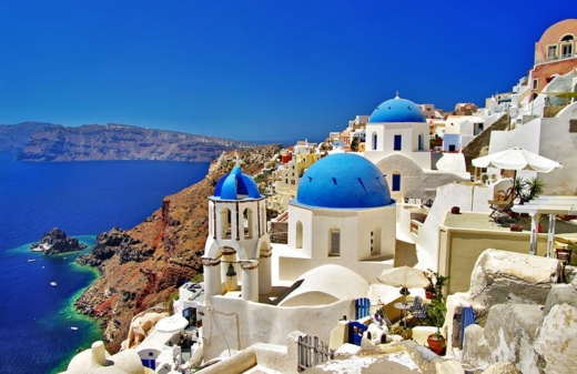 Greece Santorini    Encircling a sea-filled caldera, spectacular Santorini scores top points for dramatic beauty. Bleached white villas tumble down volcanic cliffs. Blue-domed churches rise against the sparkling sea, and bright sprays of bougainvillea add to the eye-popping canvas of color. Perched atop the black lava cliffs, the settlements of Firá and Oia are the island's most picturesque, and pricey, destinations, and Oia ranks among the most photographed locations in the world. Other highlights of the island include Akrotíri Archaeological Site, Ancient Thira, the black sand beach of Perissa, and of course, the sublime sunsets. Sailing into this stunning caldera surrounded by soaring sea cliffs makes an unforgettable first impression.