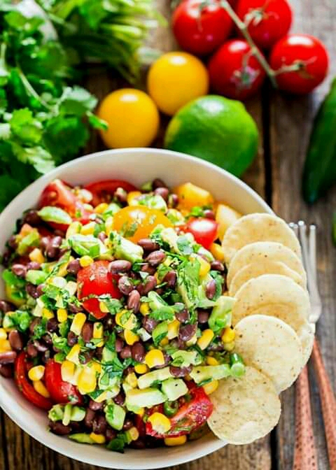 Black Bean Corn and Avocado Salad This Black Bean, Corn and Avocado Salad is a crowd pleaser, colorful and full of nutrition. This salad is great served as an entree, side or even a delicious salsa. Prep Time 15 mins Total Time 15 mins Course: SaladCuisine: AmericanKeyword: avocado, black beans, corn Servings: 4 servings Calories: 336kcal Author: Joanna Cismaru Ingredients 19 oz black beans 1 can, drained and rinsed 10 oz corn kernels 1 can, drained 2 cups tomatoes chopped 1 avocado chopped 1 jalapeno minced 1/4 cup cilantro chopped 4 green onions chopped zest from one lime 4 tbsp lime juice 1/4 tsp salt or to taste 1/4 tsp pepper or to taste Instructions To a large bowl add the black beans, corn kernels, chopped tomatoes, avocado, jalapeno pepper, cilantro and green onions. Zest one lime and add the zest to the bowl, then squeeze the lime juice from 2 limes, should be about 4 tbsp or so, then season with salt and pepper. Toss everything well together. Serve with tortilla chips. Notes This salad can also be used as a dip.   You can refrigerate this salad in an airtight container for up to a day.   Please keep in mind that nutritional information is a rough estimate and can vary greatly based on products used.   ★ Did you make this recipe? Don't forget to give it a star rating below!  Nutrition Calories: 336kcal | Carbohydrates: 54g | Protein: 15g | Fat: 9g | Saturated Fat: 1g | Sodium: 288mg | Potassium: 1046mg | Fiber: 17g | Sugar: 5g | Vitamin A: 19% | Vitamin C: 33.4% | Calcium: 6.1% | Iron: 21.5%