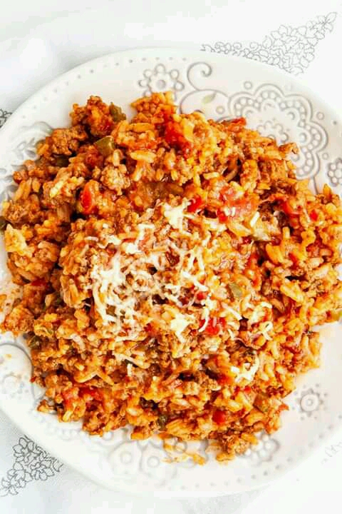 This Spanish Rice with Beef is so good, perfect to serve on its own or as a side dish and all in one pot! It's a rice dish made with ground beef, sautéed onions and garlic, rice cooked in chicken broth with diced tomatoes and perfectly spiced!